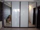 Шкафы-купе и гардеробные по индивидуальным проектам..